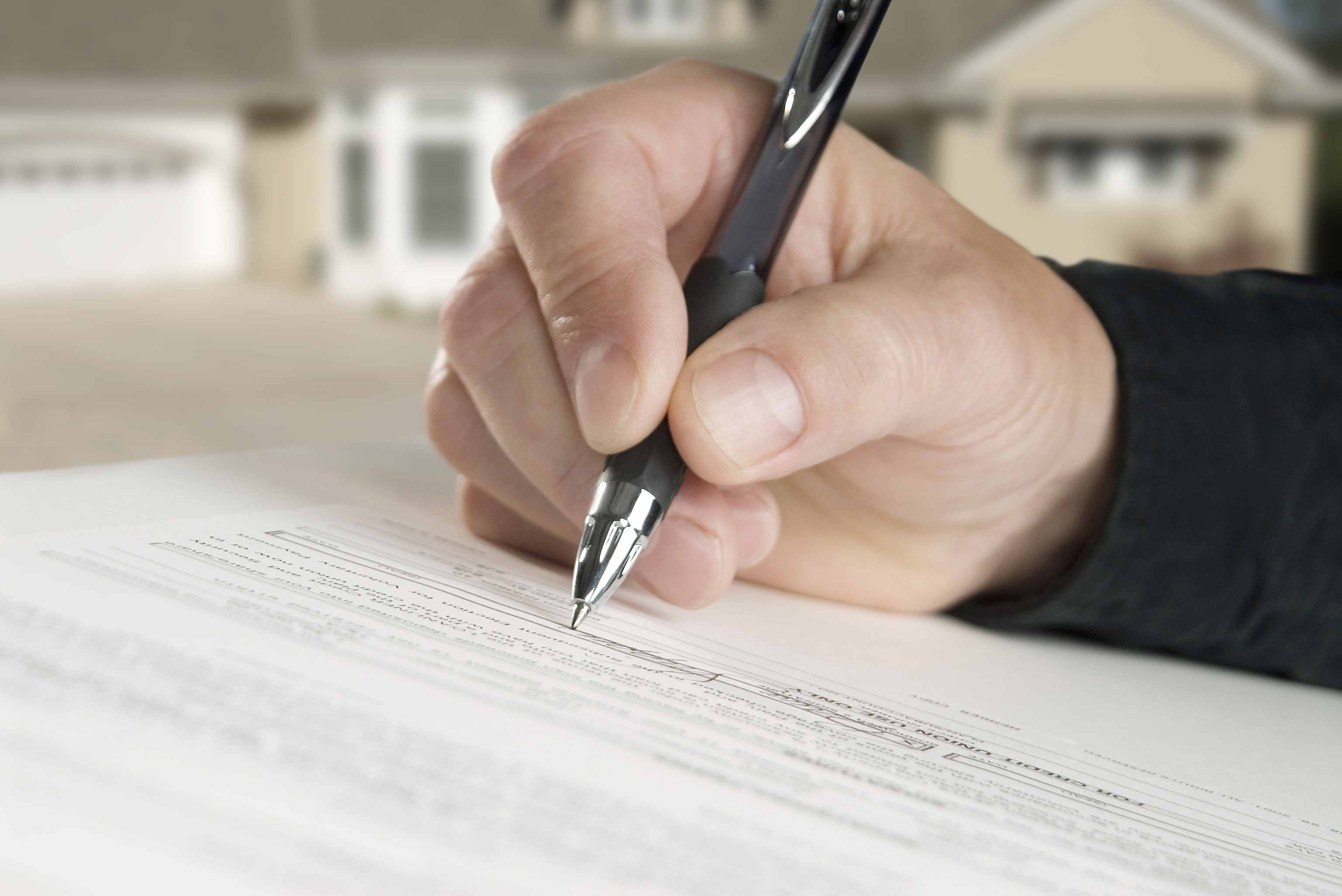signing real estate closing document