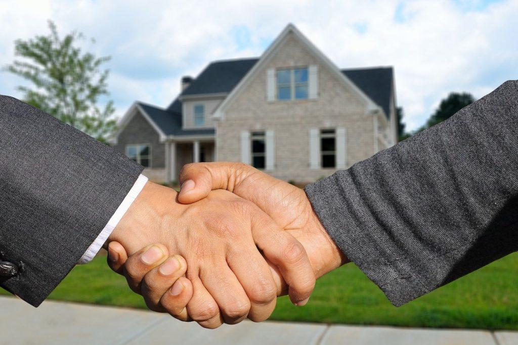homeowners handshaking house closing