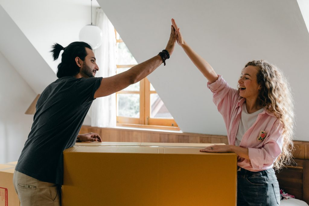 couple celebrating as new home buyers after closing